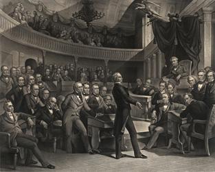 議会で演説する議員